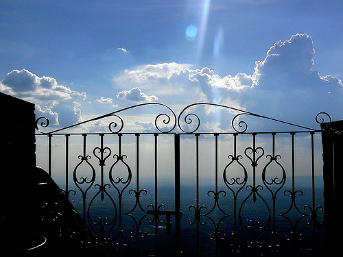 gate-and-clouds